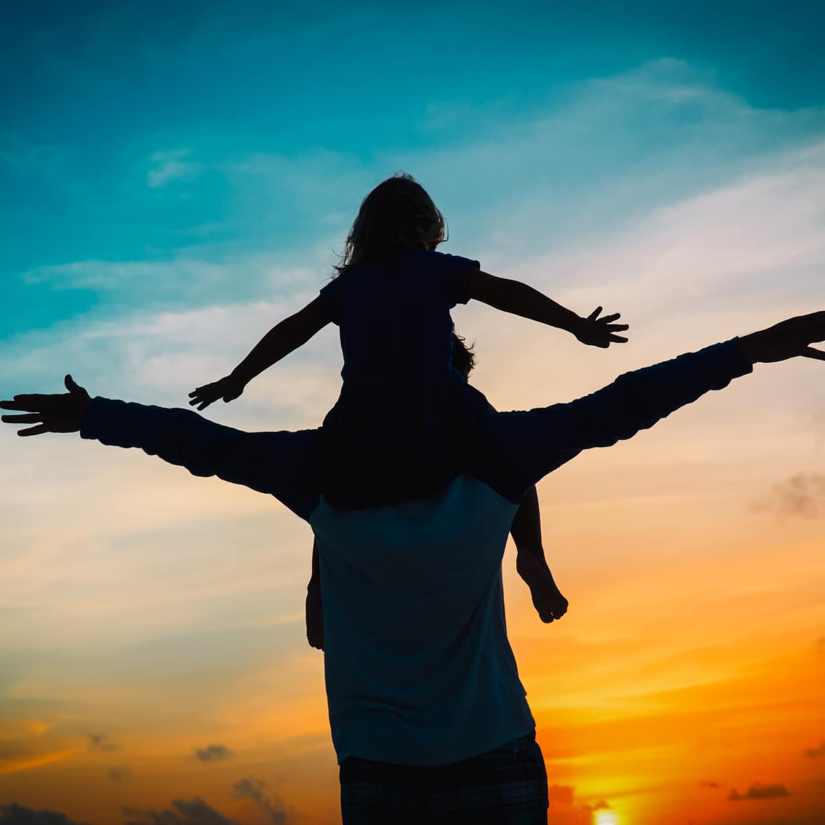 Dad with Daughter on Shoulders with Sunset